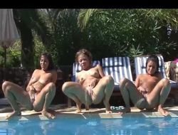 3 cuties peeing in a pool