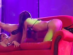 Hot lesbian babes fuck on public stage